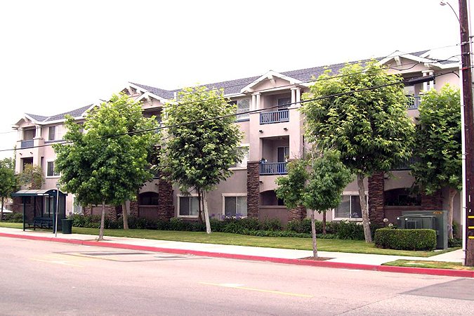 West Covina Senior living view from across the street: building and trees